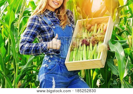 Harvest Time Concept. Portrait Of Beautiful Farmer Girl In Coveralls Showing Big Thumb Up While Hold