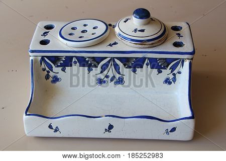 Ancient inkwell in earthenware with blue drawing