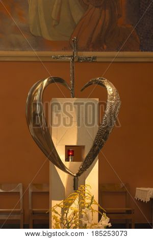 Paray Le Monial France - September 13 2016: Inside the chapel of the revelation of Jesus Margaret Mary Alacoque. Part of the famous mosaic and tabernacle in heart shape. Very important place for Catholics