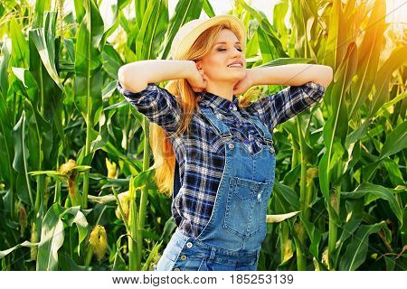Farmer Beauty. Portrait Of Beautiful And Young Red Haired Girl In Hat And Coveralls Posing To The Ca