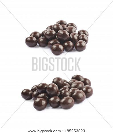 Pile of chocolate candy balls isolated over the white background, set of two different foreshortenings