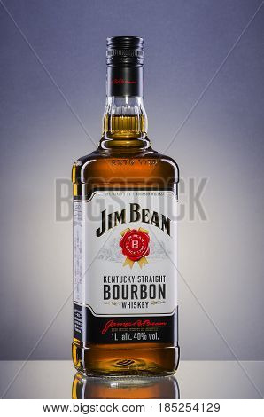 Jim Beam bourbon whiskey on gradient background. Jim Beam is owned by Beam Global Spirits and wine and it has been destiled in Clermont, Kentucky USA since 1795