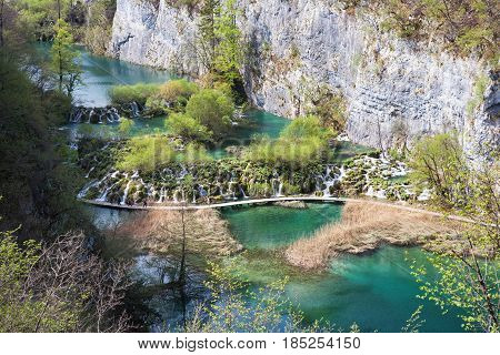 Cascade waterfalls and tourist path in Plitvice Lakes National Park Croatia