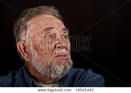 very old man grieving over loss, over black