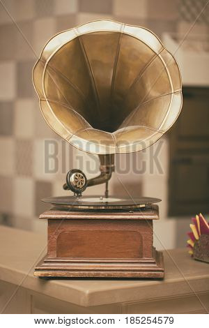 Retro old gramophone radio. Vintage style toned photo.