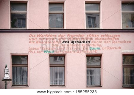 BERLIN, GERMANY - MAY 01: A political slogan applied to the facade of a residential building and old building in Berlin Kreuzberg on May 01 2017 in Berlin.