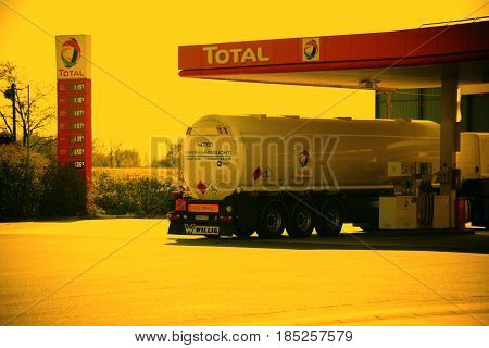 BERLIN, GERMANY - APRIL 29: A tank truck is fueling at a pumping station of the Total gas station on a resting place on May 01, 2017 in Berlin.
