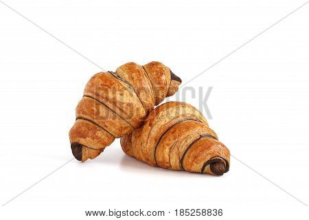 French croissants and chocolate on white background