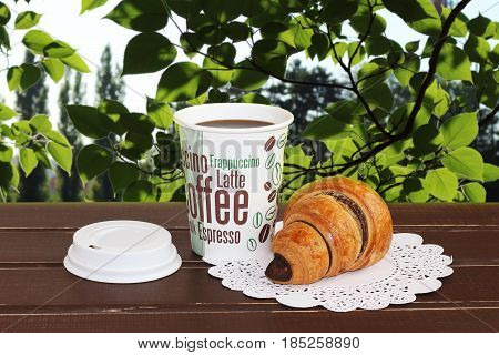French croissants and coffee in the nature