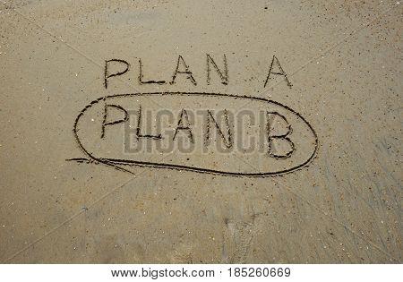 Plan B circled in the sand below Plan A
