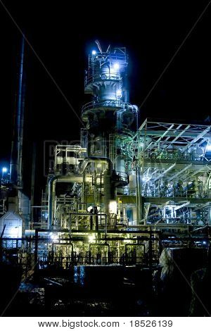 oil refinery at night with mixed color lighting