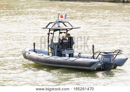 Paris; France-July 14 2016 : The Police boat is patrolling on the Seine river near Notre Dame cathedral in Paris France.