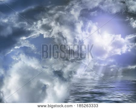 Storm clouds with rays of light and water at the bottom of the frame