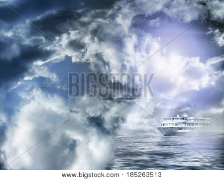 Storm clouds with rays of light and a ship in the water
