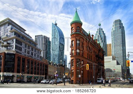 TORONTO CANADA JULY 10, 2017:  The red-brick Gooderham Building is a historic landmark of Toronto, Ontario, Canada and is the focal point of one of Toronto's most iconic vistas.