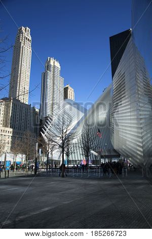 NEW YORK, USA - MARCH 24, 2017: World trade central and ground zero memorial in Manhattan, New York city in United States.