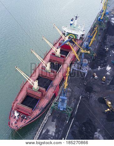 Vessel under loading in nakhodka port Russia