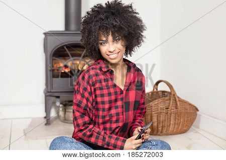 Young African American Girl With Mobile Phone.