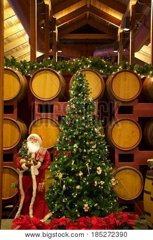 Interior daytime stock photo of Christmas tree set against wine barrels in Napa Valley, California winery