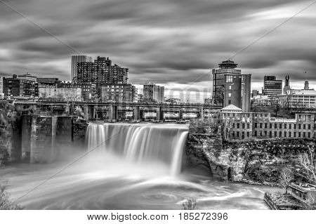 Exterior daytime black and white long exposure daytime picture of high falls in Rochester, New York in Monroe County