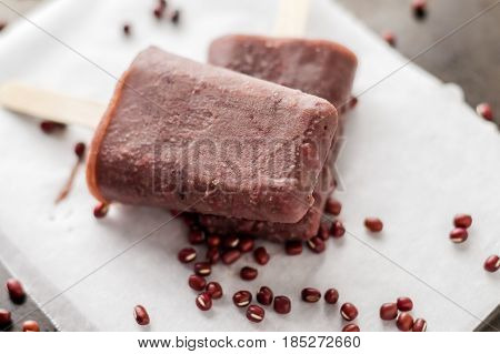 Frozen adzuki beans popsicle. Ice pops are a delicious way to cool off in hot summer days these are made of red adzuki beans ice cream a tiny Asian super food which makes this an healthy dessert!