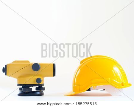 Theodolite And Construction Helmet On White Background.