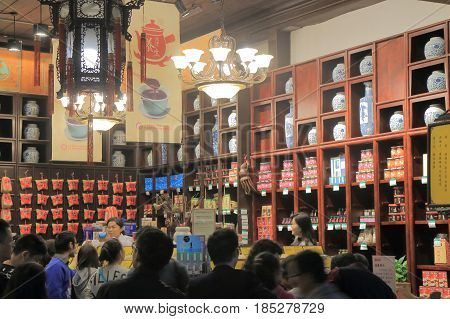 HANGZHOU CHINA - NOVEMBER 5, 2016: Unidentified people visit Chinese tea shop on Qing He Fang historical street. is a protected area of the historical buildings from the Ming and Qing dynasty.