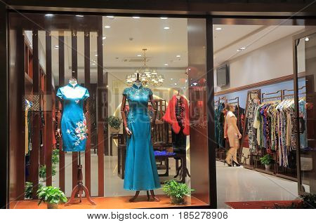 HANGZHOU CHINA - NOVEMBER 5, 2016: Traditional Chinese dress shop on Qing He Fang historical street. is a protected area of the historical buildings from the Ming and Qing dynasty.