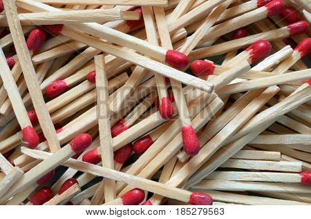 An abstract image of several wooden camping matches.
