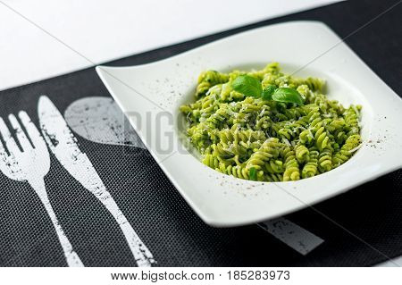 Fresh pesto pasta dish. Rotini pasta with basil pesto sauce grated parmesan cheese and fresh pepper. This Italian dish makes a delicious meal by itself or can be used as a pasta salad side.