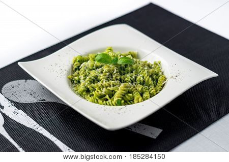 Basil pesto pasta salad. Rotini pasta with basil pesto sauce grated parmesan cheese and fresh pepper. This Italian dish makes a delicious meal by itself or can be used as a pasta salad side.