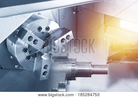 The CNC lathe or CNC Turning machine drilling the shaft.Metal shaft on the CNC lathe machine