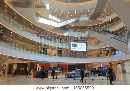 HANGZHOU CHINA - NOVEMBER 6, 2016: Unidentified people visit MIXC shopping mall. MIXC shopping mall is located in the middle of downtown business district in Hangzhou.
