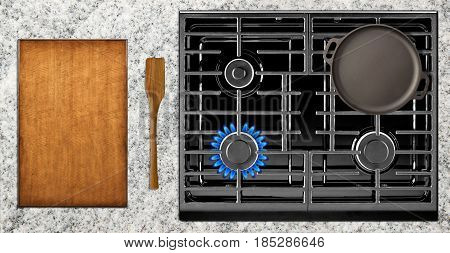 Kitchen tools and stove overlook shot on table background