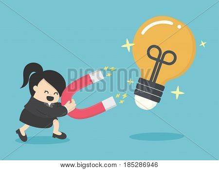 Business Woman Concept of attracting investments idea with magnet