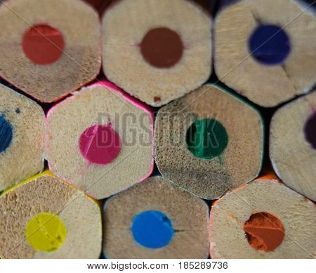Background uncultivated multicolored pencils close-up lying in three rows