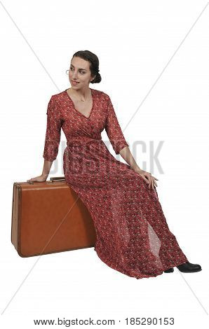 Beautiful young woman going on vacation with a vintage suitcase