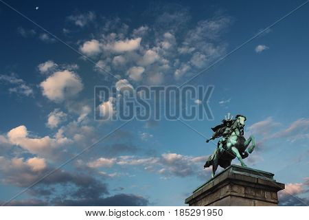 TokyoJapan 30 Dec.2016 View cloudy sky moon and statue of Kusunoki Masashige a famous Japanese samuraifrom outside Imperial Palace in Tokyo.
