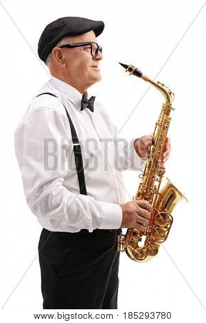Profile shot of an elderly jazz musician with a saxophone isolated on white background