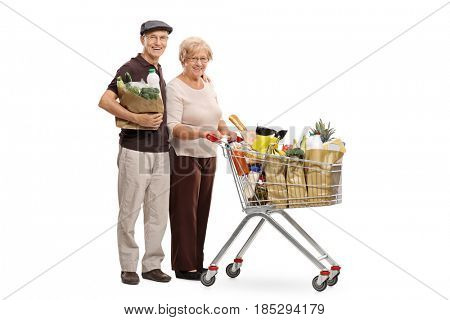 Full length portrait of an elderly man with a shopping bag and an elderly woman with a shopping cart isolated on white background