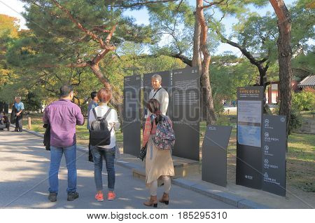 SEOUL SOUTH KOREA - OCTOBER 22, 2016: Unidentified tour guide talks to a tour group at Changdeokgung  Palace. Changdeokgung  Palace was built in15th century by King Sejong.
