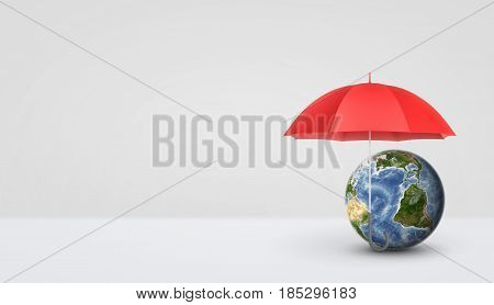 An open red umbrella standing vertically on the handle and keeping safe a small Earth globe. Protecting environment. Green business solutions. Eco-friendly.