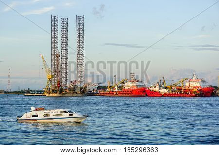 Labuan,Malaysia-May 7,2016:View of speed boat passengers with background of offshore oil & gas support vessels & Jackup Rig in Labuan island,Malaysia on 7th May 2016