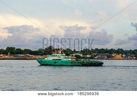 Labuan,Malaysia-May 7,2016:Platform supply vessel at Labuan island,Malaysia.A Platform supply vessel is a ship specially designed to supply offshore oil and gas platforms.