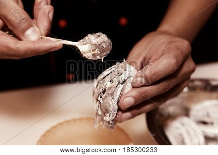 Professional cook is stuffing eggplant with minced prawns, Asian cuisine, toned image