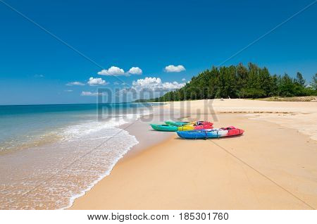 Colorful kayaks on the tropical beach and calm blue sea in Phuket island Thailand