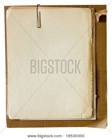 Metallic paper clip on stack of old papers. Clipping path included
