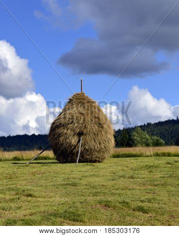 Coutryside landscape with haystack for animals feed