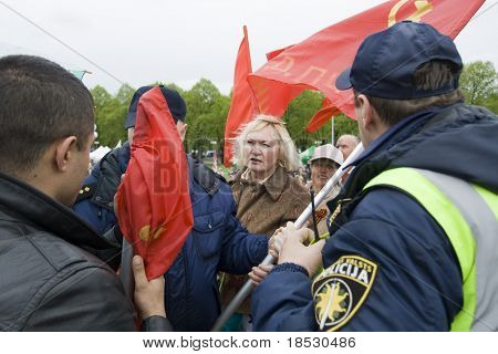 RIGA, LATVIA, MAY 9, 2009: The Police preclude to use the forbidden symbols of Soviet Union at Celebration of May 9 Victory Day (Eastern Europe) in Riga at Victory Memorial to Soviet Army