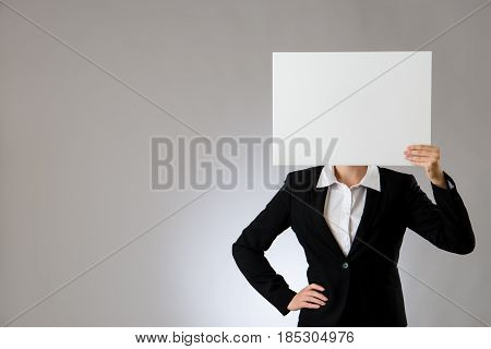 Woman Showing A Blank Sheet In Front Of Head
